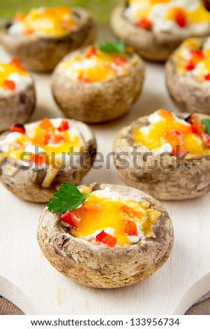 Grilled champignons stuffed cheese and paprica for buffet - stock photo