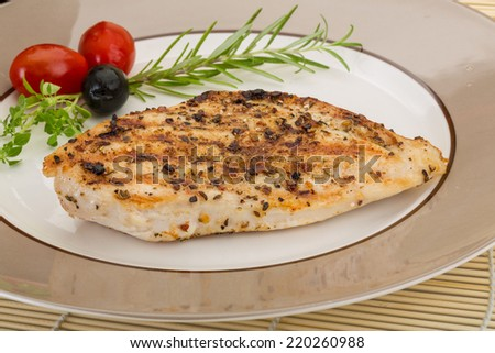 Grilled chichen breast - on the plate with spices