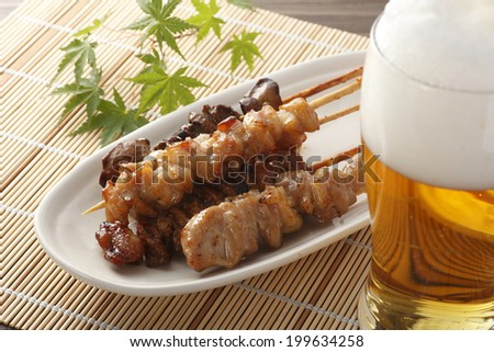 Grilled chicken and beer - stock photo
