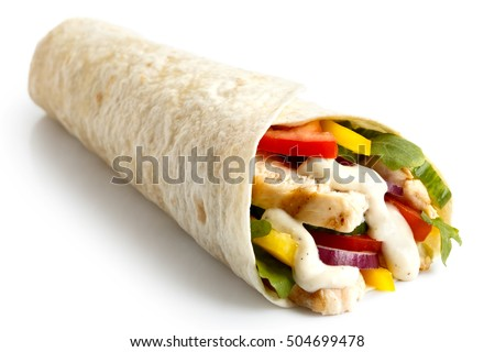 Grilled chicken and salad tortilla wrap with white sauce isolated on white.