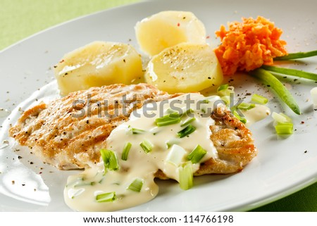 Grilled chicken breast and vegetables - stock photo