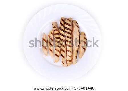 Grilled chicken breast on plate. Isolated on a white background. - stock photo