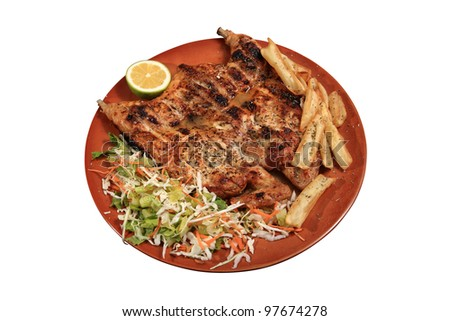 grilled chicken breast served on a plate with vegetables
