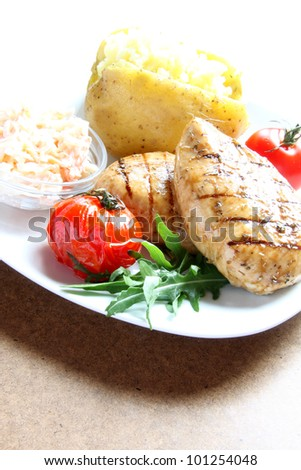 Grilled chicken breast with baked potato