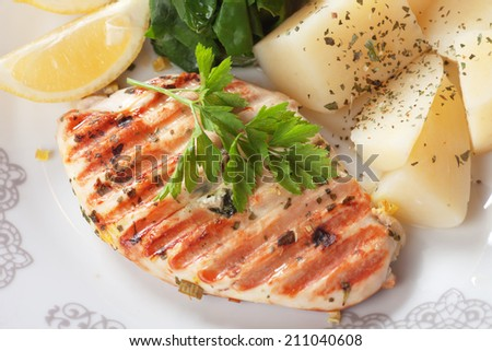 Grilled chicken breast with boiled potato and chard