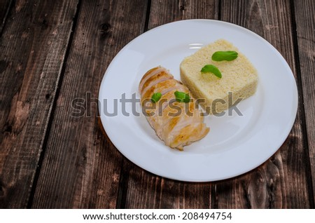 Grilled chicken breast with couscous and basil on wood table - stock photo
