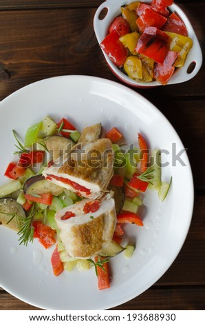 Grilled chicken breast with feta cheese and peppers
