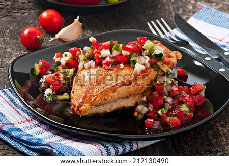 Grilled chicken breast with fresh  tomato salsa  - stock photo