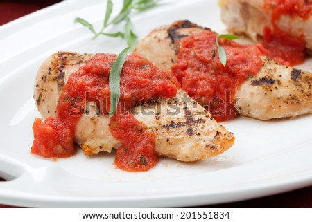Grilled chicken breast with fresh tomato tarragon sauce, spinach ...