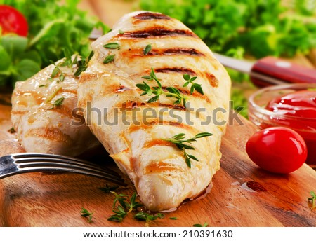 Grilled chicken breast with fresh vegetables . Selective focus - stock photo