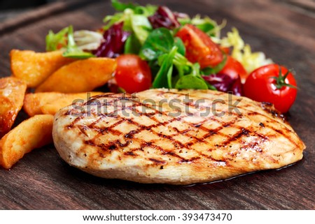 Grilled Chicken breast. with potato and vegetables - stock photo