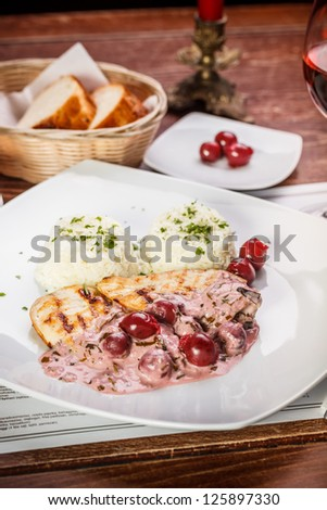 Grilled chicken breast with rice and sour cherry sauce