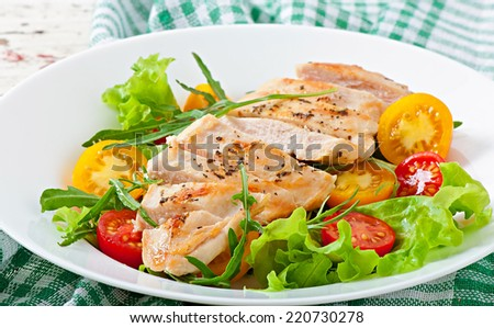 Grilled chicken breasts and fresh salad - stock photo