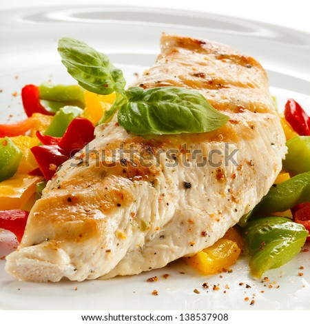 Grilled chicken breasts and vegetables - stock photo
