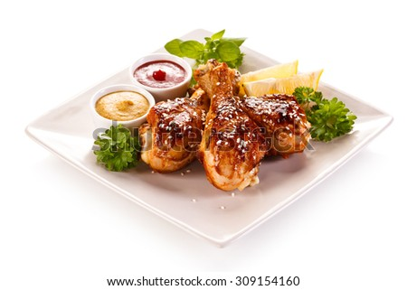 Grilled chicken drumsticks and vegetables  - stock photo