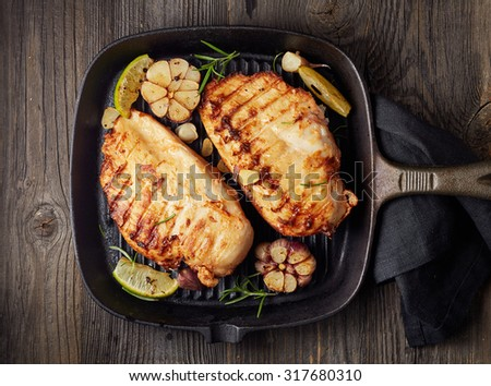 Grilled chicken fillet on a cooking pan - stock photo