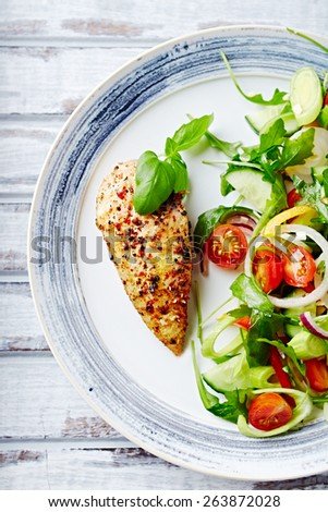 Grilled chicken fillet with colorful salad (close up)  - stock photo