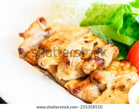 grilled chicken in Japanese restaurant - stock photo