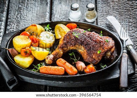 Grilled chicken leg with herbs and spices - stock photo