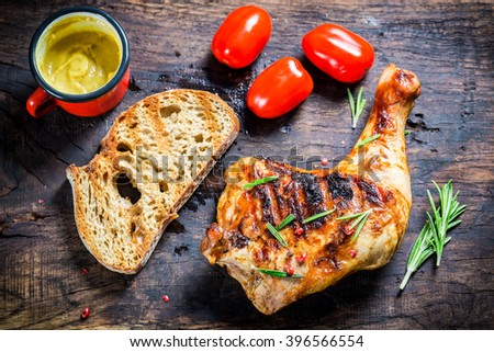 Grilled chicken leg with rosemary and pepper - stock photo