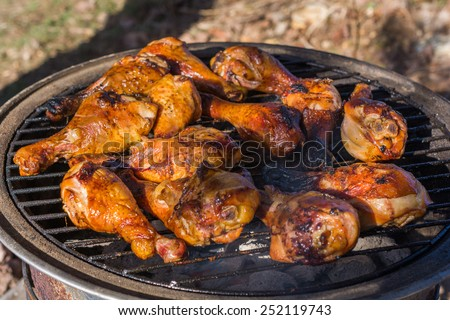 Grilled Chicken legs on outdoor barbecue grill