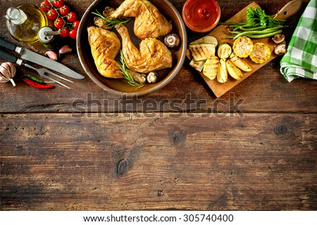 Grilled chicken legs with vegetables - stock photo