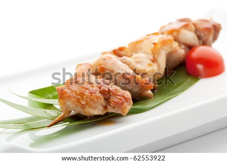 Grilled  Chicken Meat  Garnished with Cherry Tomato and Green Leaf - stock photo