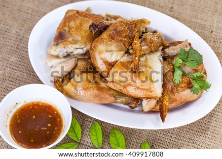 grilled chicken on plate, style thai food