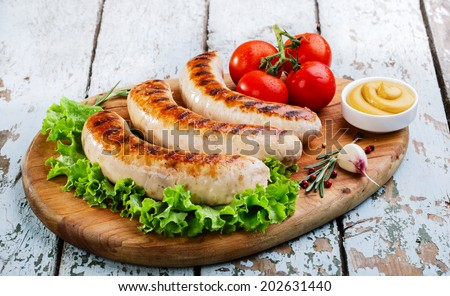Grilled chicken sausages  - stock photo
