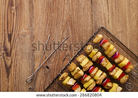 Grilled chicken skewers with pineapple, peppers and onions - stock photo