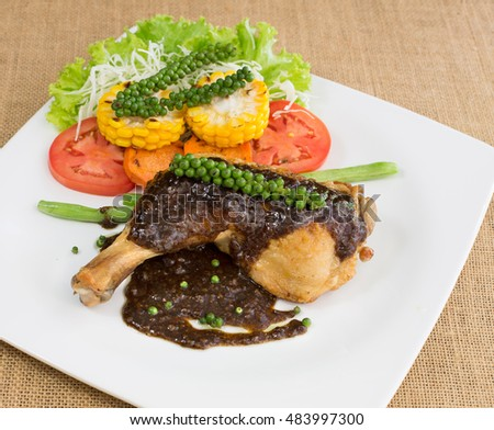 Grilled Chicken steak with black pepper sauce, In white dish On the wooden table / Select focus
