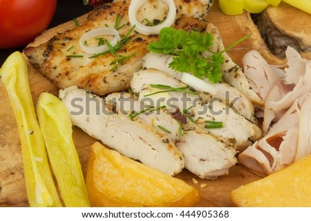 Grilled chicken steak with spices and vegetable. Dietary food for athletes. Healthy diet meals. Fried chicken. Steak ready for the grill.