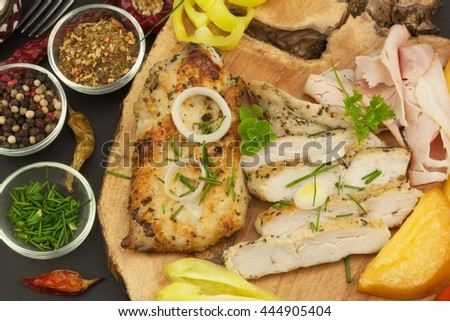 Grilled chicken steak with spices and vegetable. Dietary food for athletes. Healthy diet meals. Fried chicken. Steak ready for the grill. - stock photo