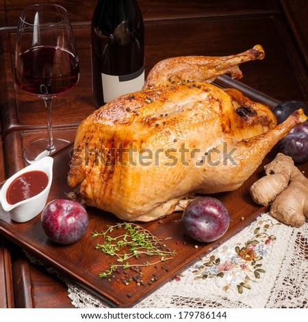 Grilled chicken stuffed with big plums and ginger with red wine - stock photo