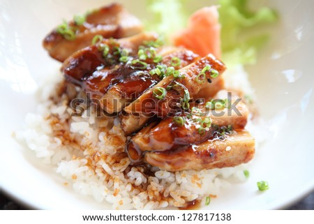 Grilled Chicken teriyaki rice on wood background - stock photo