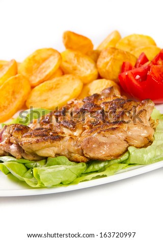 Grilled chicken thigh with potatos