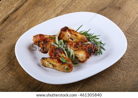 Grilled chicken wings bbq with parsley and onion