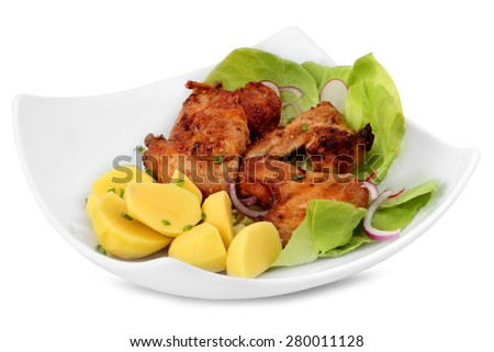 Grilled chicken wings with potatos on a ceramic plate isolated on white background - stock photo