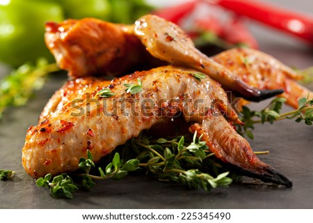 Grilled Chicken Wings with Thyme and Hot Chili Pepper - stock photo