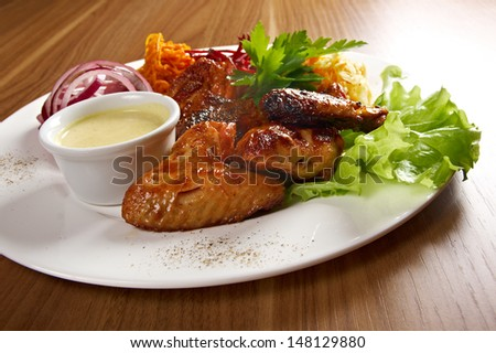 Grilled chicken wings with vegetable closeup - stock photo
