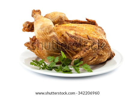 Grilled chicken with fresh herbs isolated on white background. - stock photo