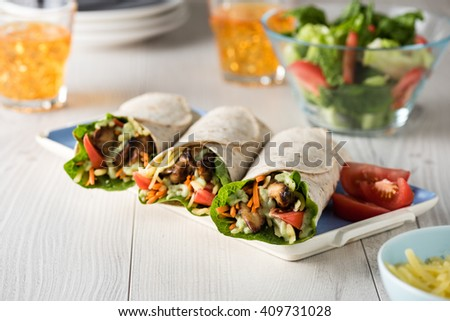Grilled chicken with fresh vegetable burrito wraps - stock photo