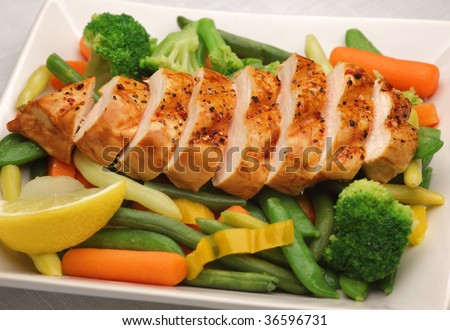 Grilled chicken with fresh vegetables - stock photo