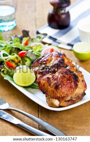 Grilled chicken with lettuce and rocket salad by sour cream dressing