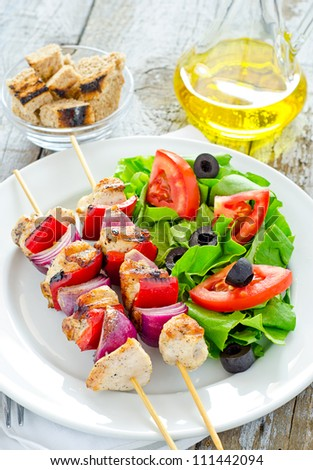 Grilled chicken with salad and tomato olive oil - stock photo