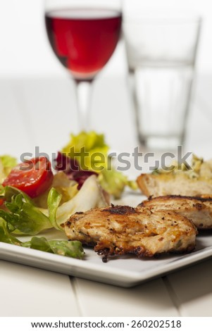 grilled chicken with salad leaves  - stock photo