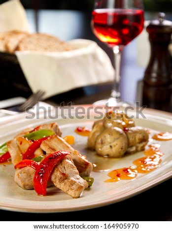 Grilled chicken with vegetables and orange reduction - stock photo