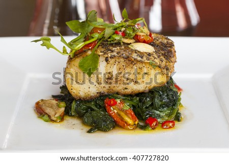 grilled codfish with vegetables and spicy