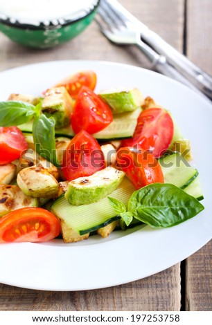 Grilled courgette, cucumber and tomato salad