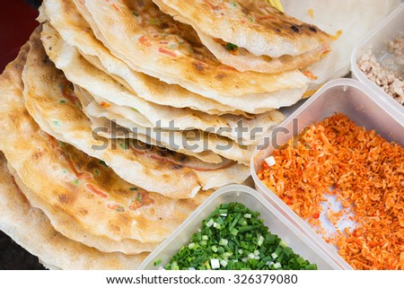 Grilled crispy puff with minced pork, egg and vegetables, Vietnamese street food in Ho Chi Minh city. - stock photo